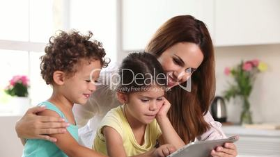 Mother and her child using tablet pc