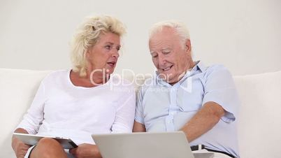 Old couple using new technology