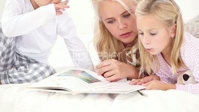 Mother reading history to her two child