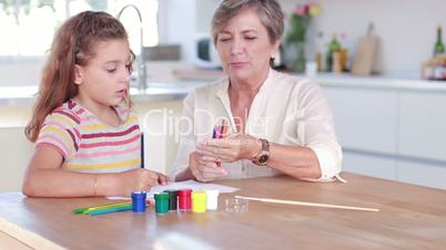 Child drawing with her granny