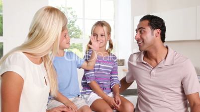 Happy family talking together