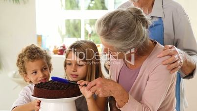 Grands parents and children making chocolate sauce