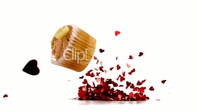 Valentines cupcakes falling on piles confetti