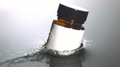 Medicine jar falling in water
