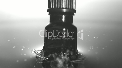 Medicine bottle dropping in water
