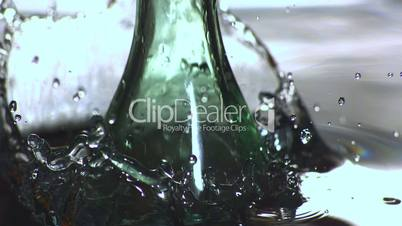 Glass bottle falling in water