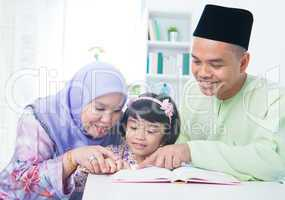 Muslim family reading book
