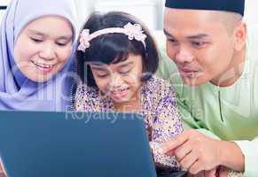 Asian family browsing internet