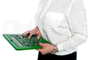Woman pressing digit 6 on calculator