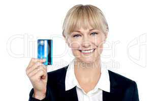 Joyous female employee showing credit card