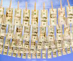 Dollar bills hanging on multiple c