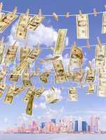 Multiple dollar bills, hanging on c