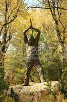 Statue of Nevada miner swinging axe