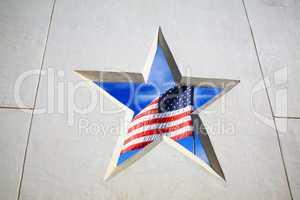 Flag and blue sky through star