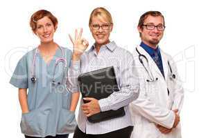 Businesswoman Making Okay Hand Sign with Doctors or Nurses