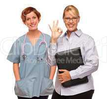 Businesswoman Making Okay Hand Sign with Doctor or Nurse