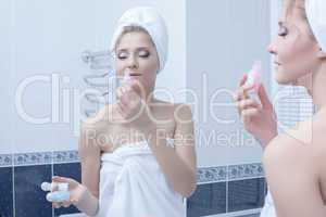 Woman in bathroom with perfume