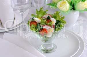 salad of vegetables with quail eggs