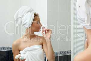 Beauty woman in bathroom smell perfume