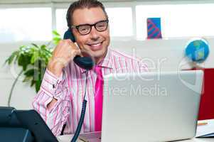 Happy executive engaged on a business call
