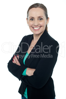 Middle aged woman posing against white background