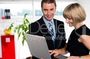 Secretary showing power point presentation to the boss