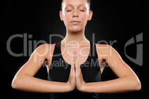Portrait of young Caucasian woman exercising yoga