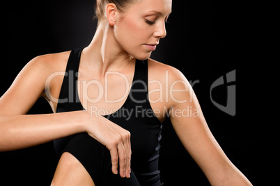 Brunette young woman in spine twisting pose