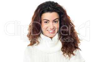 Curly haired woman posing against white