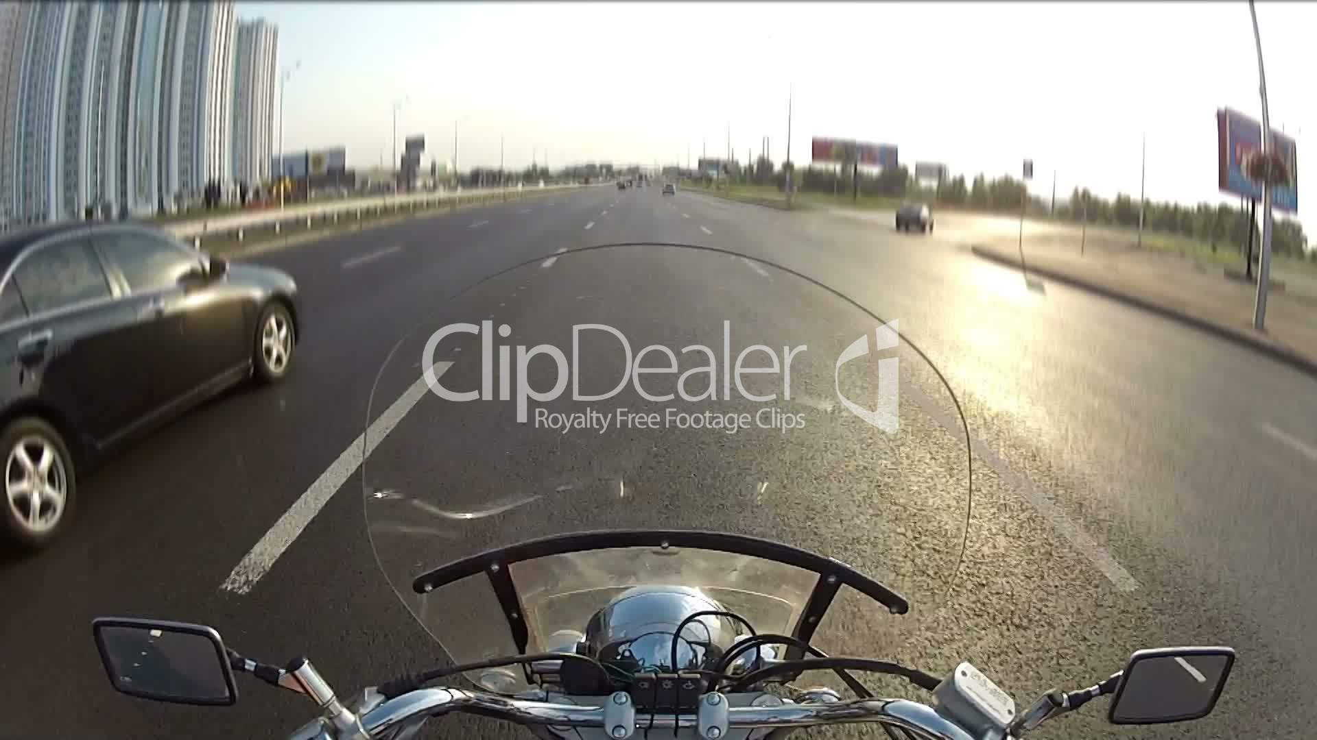 Biker driving the motorcycle on city highway, POV: Royalty