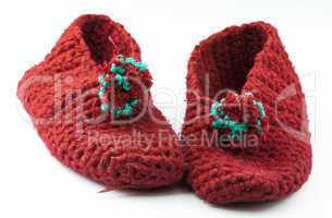 Red knitted slippers