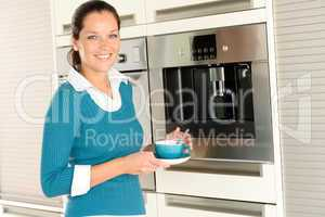 Smiling woman drinking cappuccino kitchen machine cup