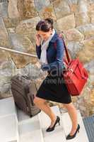 Traveling businesswoman hurried rushing climbing baggage carry-o