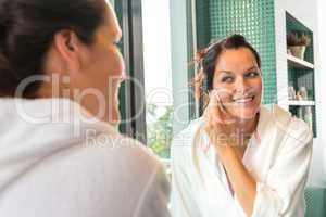 Happy woman removing make-up cleansing pads lotion