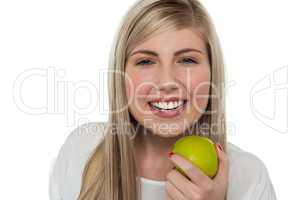 Health conscious girl holding green apple