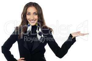 Charming flight stewardess presenting copy space