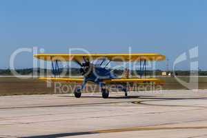 Aircraft vintage bi-plnae taxiing f