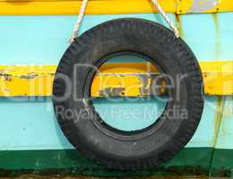 Old tyre on wooden boat