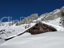 Hut in the snow, mountains
