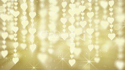 dangling gold hearts loop