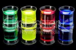 Coloured rinks in shot glass