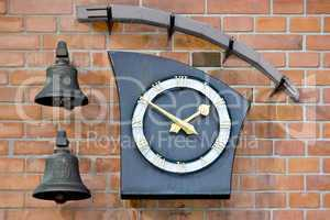 Modern wall clock and two bells