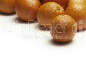 Oranges on a white surface