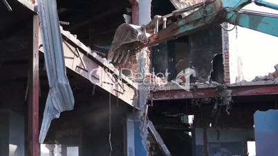 Destruction of Building With an Excavator
