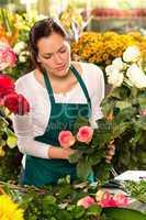 Woman florist preparing bouquet flowers shop retail