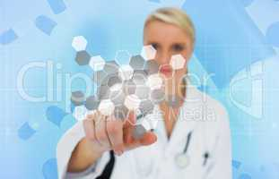 Doctor using touchscreen displaying chemical formula
