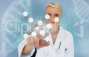 Blonde doctor selecting touchscreen displaying chemical formula