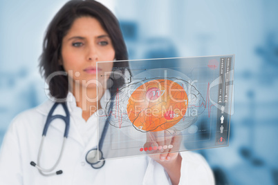 Female doctor touching a touchscreen