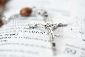 Crucifix resting on the bible