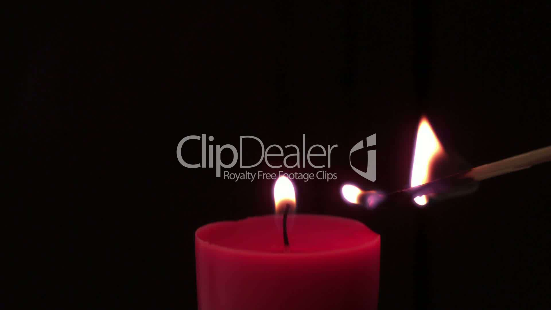Pink candle lit by match: Royalty-free video and stock footage